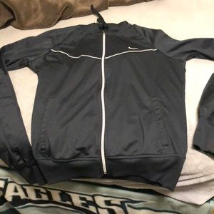 Black nike jacket with zipper and hood. Unisex